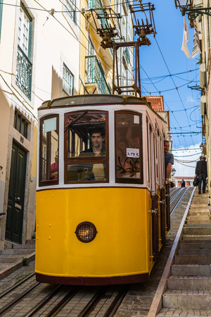 tramway: Lisbon, Portugal - May 18, 2017: Typical old tram in Lisbon, Portugal.  It is a great tourist attraction. Editorial