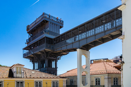 Santa Justa lift built by Raoul Mesnard in 1902 in Lisbon, Portugal. From the top terrace there is a fabulous view of Alfama, the old part of Lisbon. Editorial