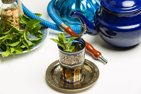 Traditional Arab mint tea in a traditional cup with mint leaves Stock Photo