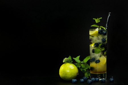 berry: Blueberry mojito with lime and mint on the black background Stock Photo