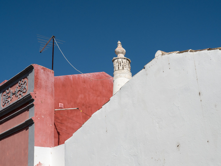 sunshade: In the old alleyways of Faro on the coast of southern Portugal, the capital of the Algarve district Stock Photo