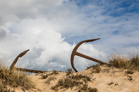 Natural Cemetery of Marine Anchors at Barril Beach on the southern Portuguese coast of the Atlantic. Stock Photo