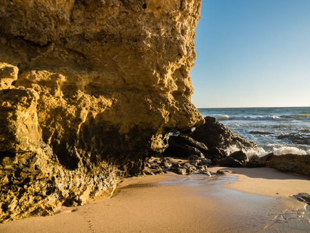 sunshade: Sandstone coastline with sandy beaches at Gale on the southern coast of Portugal