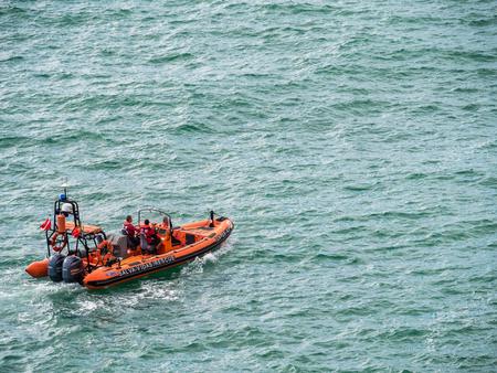 Carvoeiro , Portugal - October 20, 2017: Rescue boat patrols near Carvoeiro on the southern Atlantic coast of Portugal.