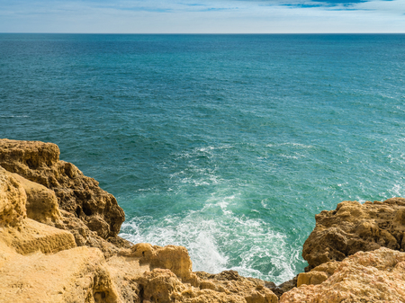 Reef formation from sandstone on the coast of Carvoeiro in southern Portugal Stock Photo