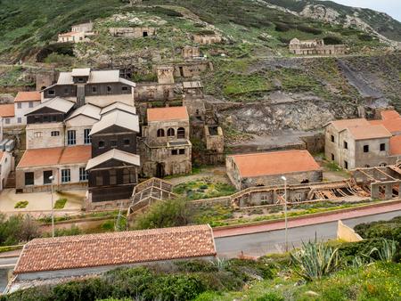 The former mining town of Argentiera, Sardinia island, Italy Standard-Bild - 100480618