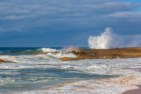 Waves of surf on the shore of the stormy Atlantic near Safi, Morocco