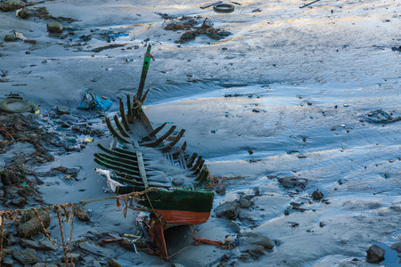 Ruins of a fishing boat in the fishing port of Safi, Morocco Imagens