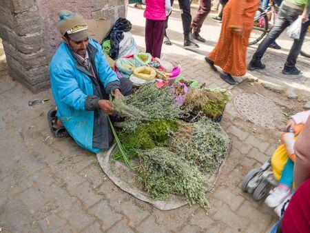 Essaouira, Morocco - October 31, 2018: Salesman herbs in Medina Essaouira. Editorial