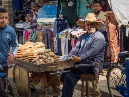 Essaouira, Morocco - October 31, 2018: Salesman breads in Medina Essaouira.