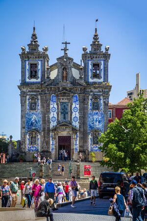 Porto, Portugal -  May 28, 2019: Church of Saint Ildefonso from 1739 in Porto is decorated with approximately 11,000 blue-white azulejo tiles. Portugal