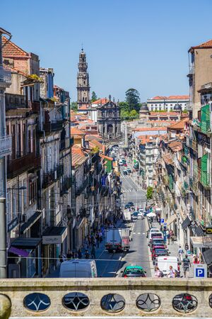 Porto, Portugal -  May 28, 2019: The atmosphere of a sunny day in the streets of the old town of Porto, Portugal