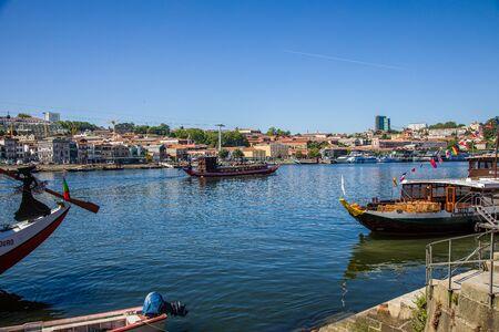 Porto, Portugal -  May 28, 2019: Boats on the Douro River in Porto, Portugal