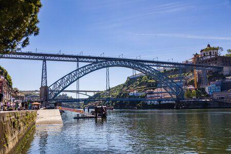 Porto, Portugal -  May 28, 2019: Iconic Dom Luís I Bridge above Douro river. Porto, Portugal