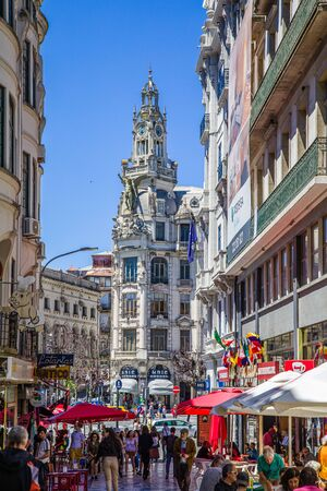 Porto, Portugal -  May 29, 2019: The atmosphere of a sunny day in the streets of the old town of Porto, Portugal