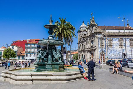 Porto, Portugal -  May 28, 2019: Square with Lion fountain in Porto