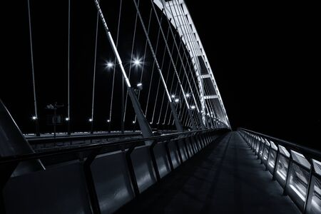 Night view of Apollo bridge over Danube river, Bratislava, Slovakia
