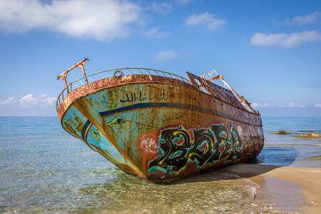 Corfu island, Greece - 15 Oct 2019: Wreck of a fishing boat on Corfu island, Greece Editorial