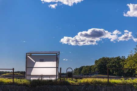 An empty bus stop illuminated by autumn sunlight Zdjęcie Seryjne