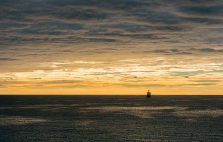A ship navigating on the morning