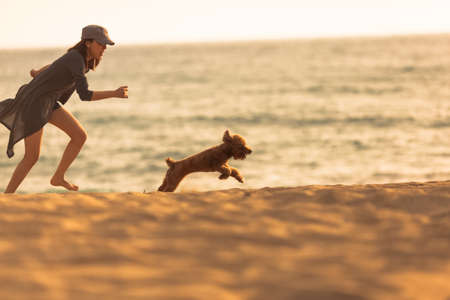 girl chasing the puppy