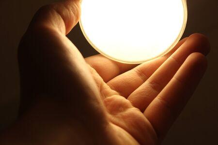 Holding a light