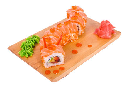 Sushi with salmon and caviar in the rice on a light background photo