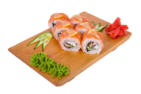 Sushi with salmon and lemon in the rice on a light background photo