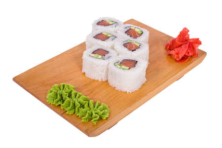 Sushi with tuna and sesame seeds in the rice on a light background photo