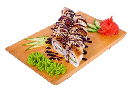 Sushi eel, sesame sauce in the rice on a light background photo
