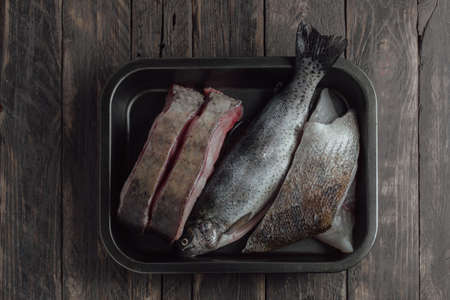 fishery products: raw fish on a wooden table Stock Photo