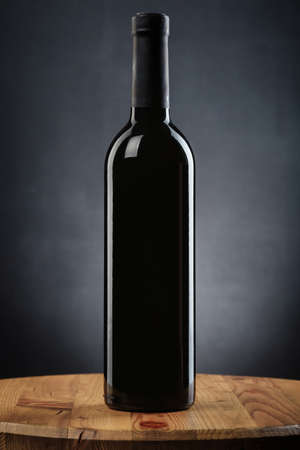 winy: Bottle of wine on a wooden table Stock Photo
