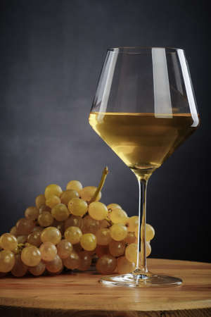 winy: glass of white wine and grapes
