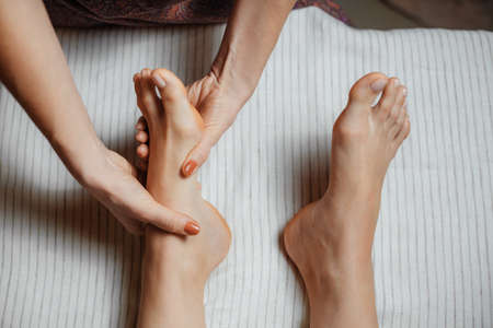 footcare: Spa massage. Foot massage with both hands