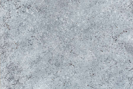 texture of an old stone interspersed with spray brushes in cold colors 写真素材