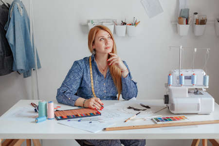 the young designer creates the eksikzy in his studio, a small business, the tailor works at home on the order. Sews clothes