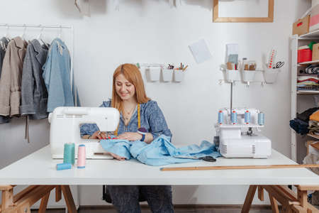 Woman working at home and taking orders. Seamstress working in studio