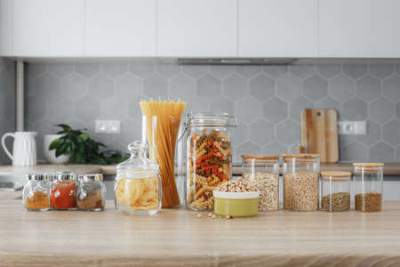 spices and pasta in jars on the table Imagens