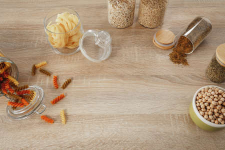 pasta and spices on the wooden table