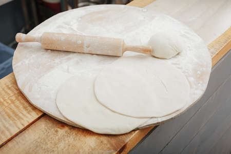 making dough for handmade pizza in cafe