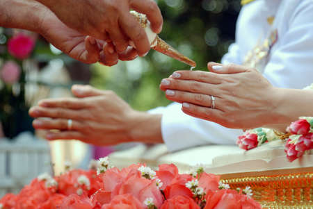 Traditional Thai Wedding - Thai spouse blessed by guests in wedding ceremony Stock Photo