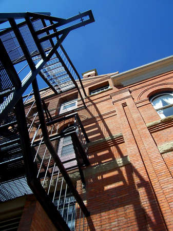 An angular shot of an old fashioned fire escape and brick building. Stock Photo - 2630468