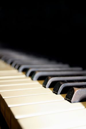 Looking down a set of classic ebony and ivory piano keys.