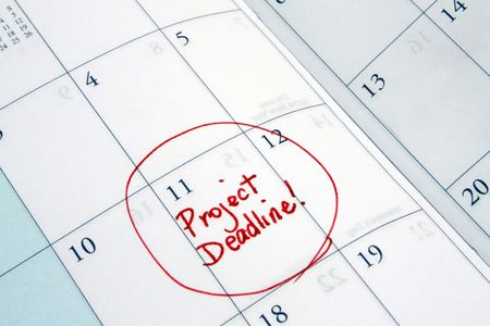 project deadline: A daytimer is scheduled as having a project deadline in it.