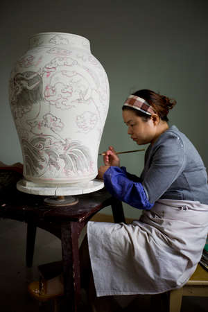 artist painting: An artist painting porcelain