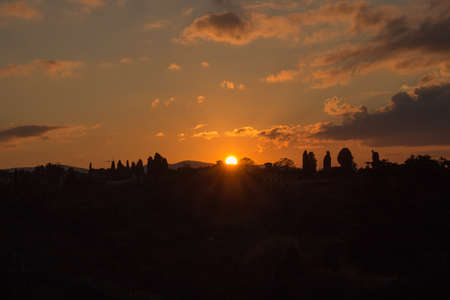 The view of the lights of the sun. Sunset in Florence. Tuscany. Italy. Imagens