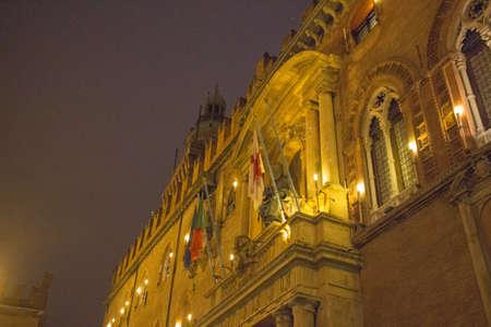 commune: Italy, Bologna - November 20 2016: facade detail of Palazzo dAccursio at Piazza Maggiore by night on November 20 2016 in Bologna, Emilia Romagna , Italy.