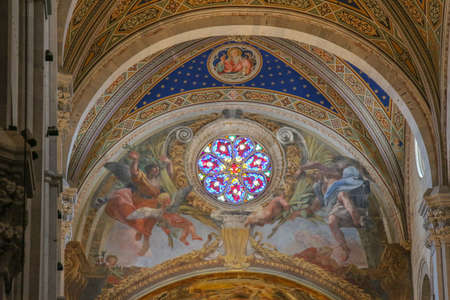 Italy, Lucca - September 18 2016: the view of fresco and stained glass window on the interior of Lucca Cathedral. Cattedrale di San Martino on September 18 2016 in Lucca, Tuscany, Italy. Editorial