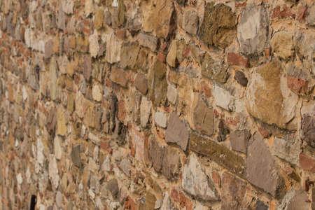 View of an ancient brick wall. Ancient brickwork. Stock Photo
