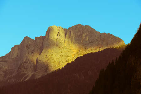 The view of mountain massif at sunset light. Stock Photo